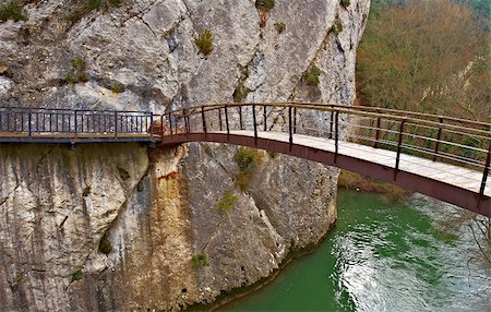 Mounted on the Rocks Wooden Bridge over the River Aragon Stock Photo - Budget Royalty-Free & Subscription, Code: 400-04877094