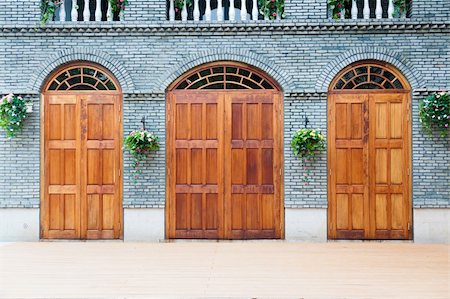 Traditional Chinese house  with wooden arch doors and deck,architectural style of Ming and Qing Dynasties Stock Photo - Budget Royalty-Free & Subscription, Code: 400-04877774