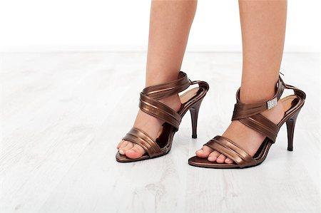 High heel shoes on child feet - closeup Stock Photo - Budget Royalty-Free & Subscription, Code: 400-04886050