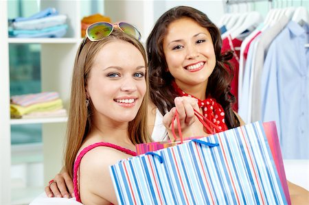 pressmaster - Portrait of smiling shoppers looking at camera after shopping Stock Photo - Budget Royalty-Free & Subscription, Code: 400-04880460