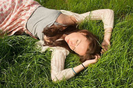 beautiful girl lying on grass and having fun Stock Photo - Budget Royalty-Free & Subscription, Code: 400-04882783