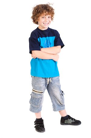 Young preschool boy posing with arms crossed isolated on white background... Stock Photo - Budget Royalty-Free & Subscription, Code: 400-04883453