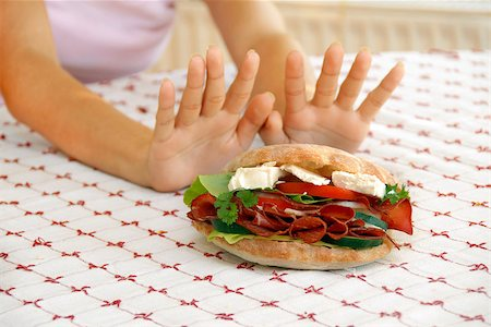 female hands refusing big meat sandwich with ham and cheese Stock Photo - Budget Royalty-Free & Subscription, Code: 400-04896913