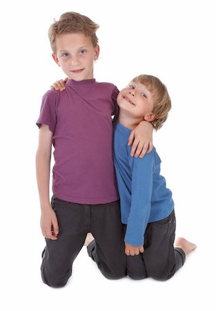 two happy brothers against white background Stock Photo - Budget Royalty-Free & Subscription, Code: 400-04899994