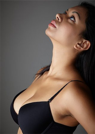 female naked large breasts or boobs - Young voluptuous Indian adult woman with long black hair wearing black lingerie and blue coloured contact lenses on a neutral grey background. Mixed ethnicity Stock Photo - Budget Royalty-Free & Subscription, Code: 400-04893805