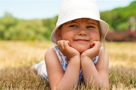 raysay (artist) - Little adorable girl posing in the park Stock Photo - Budget Royalty-Free & Subscription, Code: 400-04893847