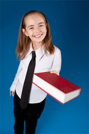 education loan - Little girl giving a book Stock Photo - Budget Royalty-Free & Subscription, Code: 400-04902154