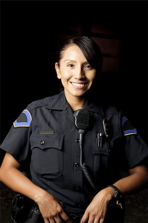female police officer happy - a smiling police officer posing for her portrait in the night. Stock Photo - Budget Royalty-Free & Subscription, Code: 400-04919650