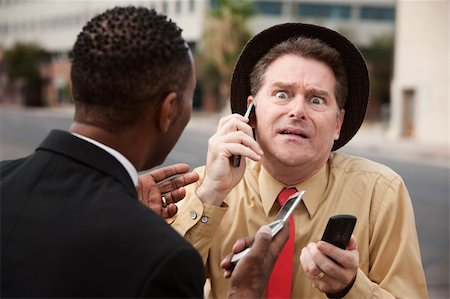 Scared Caucasian businessman with friend on a phone call Stock Photo - Budget Royalty-Free & Subscription, Code: 400-04910548
