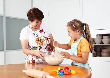 Grandmother and granddaughter baking and having fun together Stock Photo - Budget Royalty-Free & Subscription, Code: 400-04913161