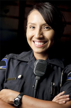female police officer happy - a female police officer smiling at night and posing for her portrait. Stock Photo - Budget Royalty-Free & Subscription, Code: 400-04920003