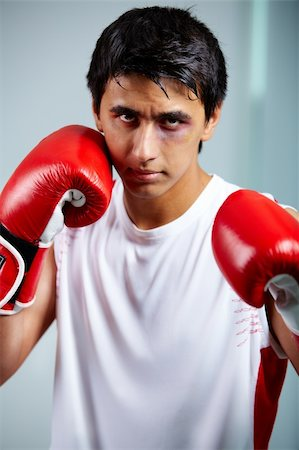 Image of a boxer in red gloves ready to attack his rival Stock Photo - Budget Royalty-Free & Subscription, Code: 400-04922398