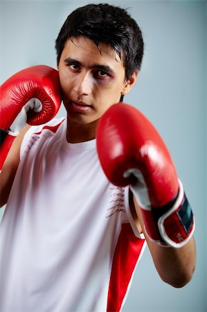 Image of a boxer in red gloves ready to attack his rival Stock Photo - Budget Royalty-Free & Subscription, Code: 400-04922400