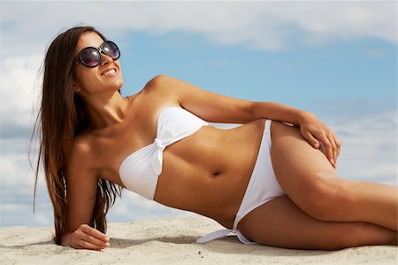Image of female in white bikini sunbathing on sandy beach Stock Photo - Budget Royalty-Free & Subscription, Code: 400-04922411
