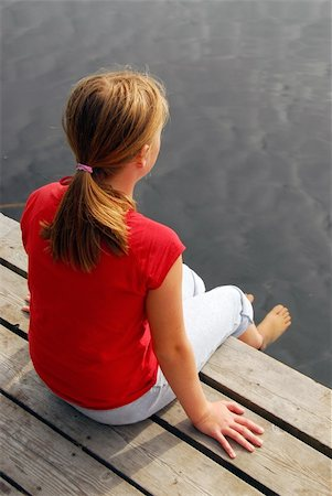 preteen girl feet - Young girl dipping feet in the lake from a wooden boat dock Stock Photo - Budget Royalty-Free & Subscription, Code: 400-04934259