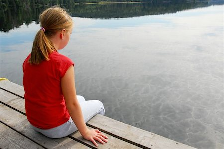 preteen girl feet - Young girl dipping feet in the lake from the edge of a wooden boat dock Stock Photo - Budget Royalty-Free & Subscription, Code: 400-04934260