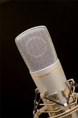 song microphone on black background Stock Photo - Budget Royalty-Free & Subscription, Code: 400-04934711