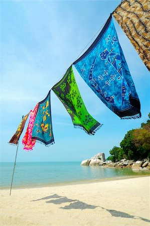 simsearch:400-04638538,k - Batik is hanged at the beach. Batik is hand-dying clothes, is traditional handicraft in tropical country like Malaysia and Hawaii. Stock Photo - Budget Royalty-Free & Subscription, Code: 400-04931873
