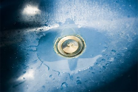 flooded homes - Down the Drain  Blue Ceramic Bathroom Sink.  Close-up on drain flooded with water. Stock Photo - Budget Royalty-Free & Subscription, Code: 400-04932466