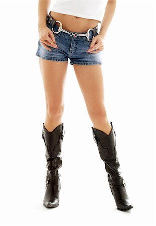 simsearch:400-04096935,k - long legs in cowboy boots and denim shorts over white Stock Photo - Budget Royalty-Free & Subscription, Code: 400-04944073