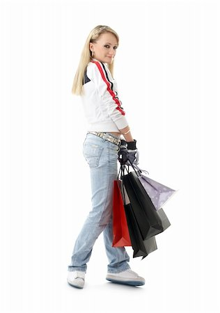 teenage girl with shopping bags over white Stock Photo - Budget Royalty-Free & Subscription, Code: 400-04944187