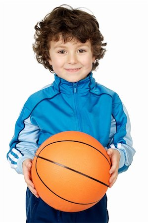 adorable child playing the basketball a over white background Stock Photo - Budget Royalty-Free & Subscription, Code: 400-04948895