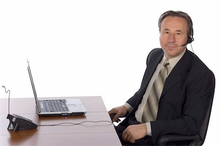 isolated businessman at the desk with headset Stock Photo - Budget Royalty-Free & Subscription, Code: 400-04941175