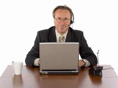 isolated businessman at the desk with headset Stock Photo - Budget Royalty-Free & Subscription, Code: 400-04941304