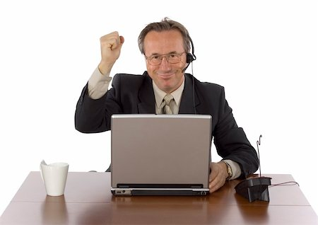 isolated successful businessman at the desk with headset Stock Photo - Budget Royalty-Free & Subscription, Code: 400-04941305