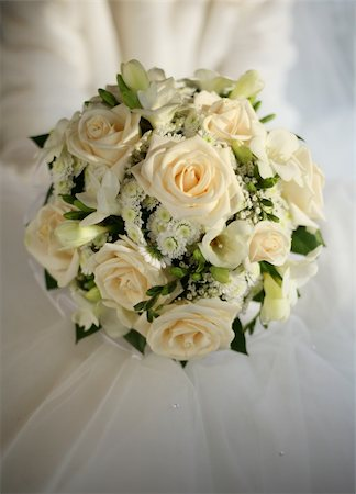 Wedding bouquet from beige roses on a background of a wedding dress Stock Photo - Budget Royalty-Free & Subscription, Code: 400-04941374