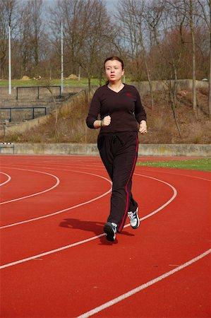 sweaty woman - Teenage Girl Jogging in a Stadium Stock Photo - Budget Royalty-Free & Subscription, Code: 400-04942139