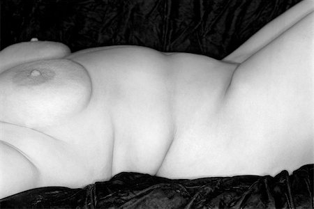 Nude full-figured Caucasian woman lying on back. Stock Photo - Budget Royalty-Free & Subscription, Code: 400-04955194