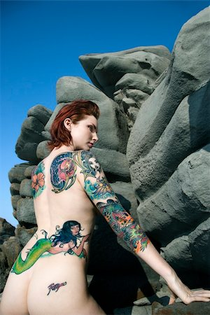 Sexy nude tattooed Caucasian woman standing by rocky formation in Maui, Hawaii, USA. Stock Photo - Budget Royalty-Free & Subscription, Code: 400-04955688
