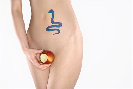 snake skin - Portrait of nude attractive redhead Caucasian young woman with snake tattoo holding apple. Stock Photo - Budget Royalty-Free & Subscription, Code: 400-04955768
