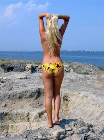 simsearch:400-04002563,k - The sexual girl standing on a stone and looks at the sea Stock Photo - Budget Royalty-Free & Subscription, Code: 400-04956125
