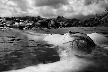 Breast of young Asian nude woman floating on back in water on rocky coast in Hawaii. Stock Photo - Budget Royalty-Free & Subscription, Code: 400-04956624