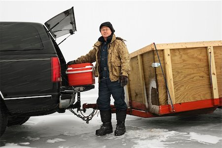 Caucasian man unloading cooler from truck with trailer on frozen lake going ice fishing in Green Lake, Minnesota, USA. Stock Photo - Budget Royalty-Free & Subscription, Code: 400-04957601