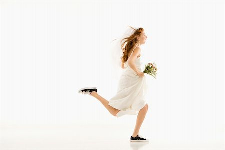 running away scared - Caucasian bride running and holding bouquet. Stock Photo - Budget Royalty-Free & Subscription, Code: 400-04950359