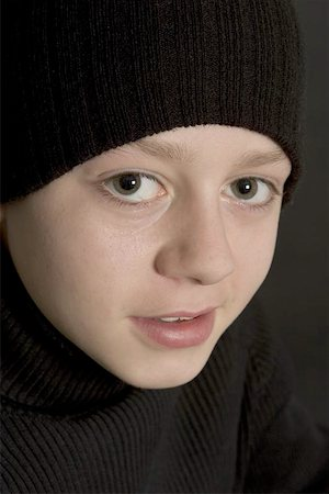 teeneage boy in black beenie hat agasint black backdrop Stock Photo - Budget Royalty-Free & Subscription, Code: 400-04969226