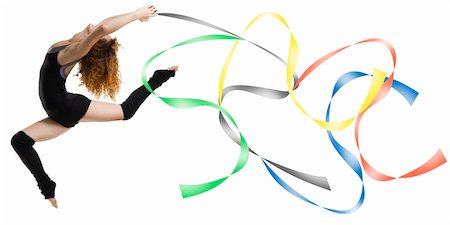 feet gymnast - a modern dancer with black dress jumping with colored strings Olympic color Stock Photo - Budget Royalty-Free & Subscription, Code: 400-04961893