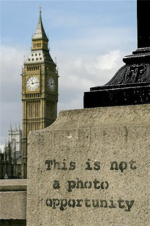 Graffiti on a lamp-post across the Thames river from Big Ben in London.  Big Ben is slighty out of focus in the distance while the graffiti is in focus. Stock Photo - Budget Royalty-Free & Subscription, Code: 400-04974934