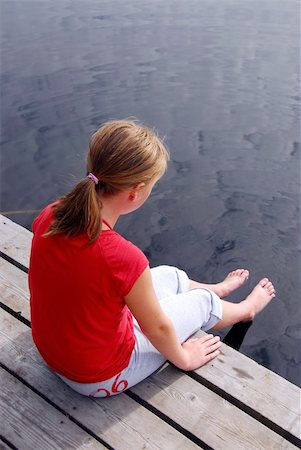 preteen girl feet - Young girl sitting on the edge of boat dock dipping her feet in water Stock Photo - Budget Royalty-Free & Subscription, Code: 400-04978436