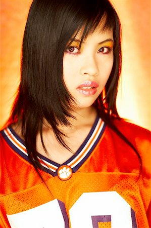 sweaty woman - Portrait of attractive beautiful young sexy model with impressive makeup wearing orange sports football jersey Stock Photo - Budget Royalty-Free & Subscription, Code: 400-04970069