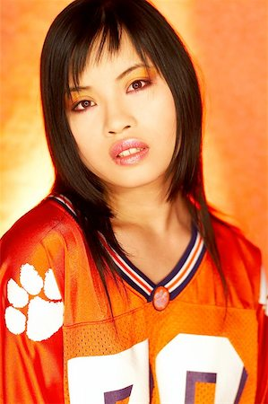 sweaty woman - Portrait of attractive beautiful young sexy model with impressive makeup wearing orange sports football jersey Stock Photo - Budget Royalty-Free & Subscription, Code: 400-04970071