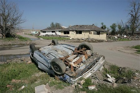 flooded homes - A heavily damaged and overturned car near the Industrial Canal in the Ninth Ward of New Orleans. Houses off their foundations sit in the background. Stock Photo - Budget Royalty-Free & Subscription, Code: 400-04971934