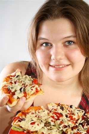 fat italian woman - Beautiful no make-up girl eating a piece of Pizza Stock Photo - Budget Royalty-Free & Subscription, Code: 400-04985045