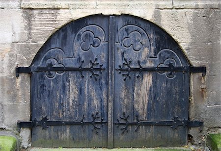 Ancient dark blue church gate, are locked from within. Stock Photo - Budget Royalty-Free & Subscription, Code: 400-04987065