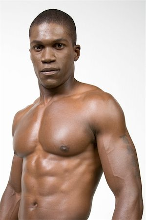 skinny man muscle pose - African American Athlete shows some muscle Stock Photo - Budget Royalty-Free & Subscription, Code: 400-04987134