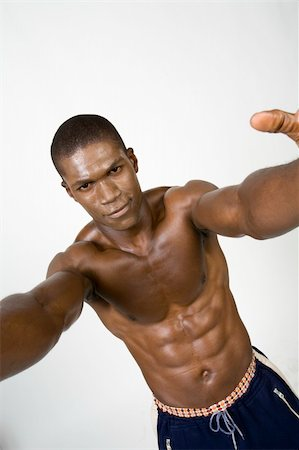skinny man muscle pose - African American Athlete shows some muscle Stock Photo - Budget Royalty-Free & Subscription, Code: 400-04987135