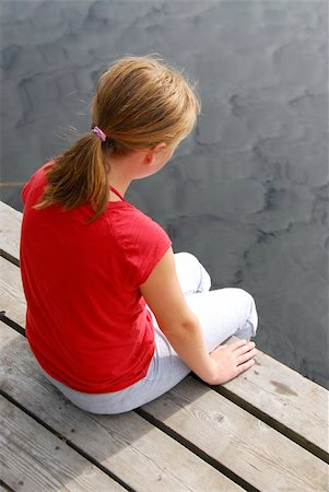 preteen girl feet - Young girl dipping feet in the lake from the edge of a wooden boat dock Stock Photo - Budget Royalty-Free & Subscription, Code: 400-04981130